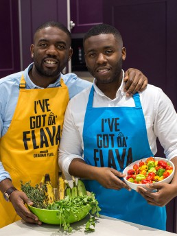 two men with aprons and vegetables