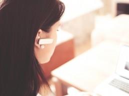Woman listening to Webinar